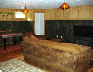Den in new basement after remodeling by Harrelson's Home Improvement